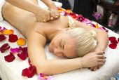 Girl on procedure Balinese massage — Stock Photo