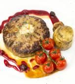 Steak with tomato sauce and mushrooms — Stock Photo