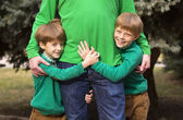Brothers hugging their father — Stock Photo
