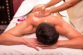 Man engaged in Ayurvedic spa treatment — Stock Photo