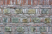 Old brick wall with stones — Photo