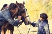 Father and son with horse — Stock Photo
