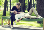 Man and woman relaxing in park — Stock Photo