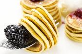 Sweet little pancakes with blackberry jam — Stock Photo