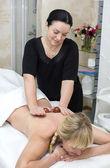 Woman doing massage — Stock Photo