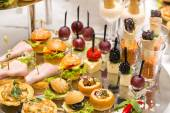 Canapes of cheese, meat and seafood — Stockfoto