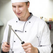 Chef sharping knife — Stock Photo #61149147