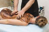 Woman during coffee massage procedure — Photo
