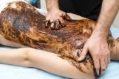 Woman during coffee massage procedure — Stock Photo