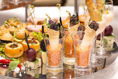 Canapes of cheese, meat and seafood — Стоковое фото