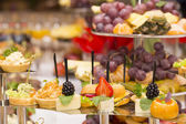 Canapes of cheese, meat and seafood — Stock Photo