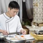 Chef preparing sushi rolls — Stock Photo #66078623