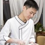 Chef preparing sushi rolls — Stock Photo #66078797