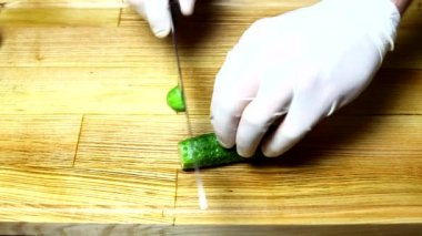 Chef hands chopping cucumber — Stock Video