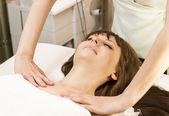 Woman on face massage procedure — Stock Photo