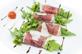 Meat rolls with arugula — Stock Photo