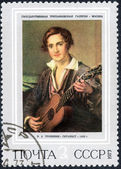 Guitarist printed stamp — Stock Photo