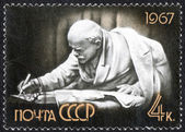 Lenin benting on papers stamp — Stock Photo