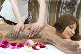 Girl doing a clay massage — 图库照片