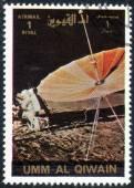 Stamp printed in UMM-AL-QIWAIN — Stock Photo