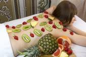 Fruity young girl doing a massage — Stock Photo