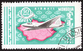 Stamp shows flying airplane — Stock Photo