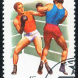 Stamp shows two boxers fighting. — Stock Photo #79809176