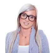 Young woman in blazer smiling — Stock Photo