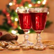 Two glasses of mulled wine with gingerbread and spices — Stock Photo #57171117