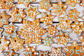 Christmas gingerbread cookies on white table — Foto de Stock