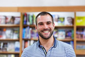 Portrait of a man in a bookstore — Stock Photo