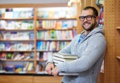Man in the library — Stock Photo