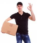 Delivery man holding a cardboard box — Stock Photo