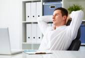 Businessman resting in office — Stock Photo