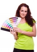 Young girl holding color swatch — Stock Photo
