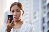 Portrait sad business woman typing sms phone street — Stock Photo