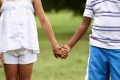 Children love black boy white girl holding hands — Stock Photo