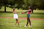 Children playing ring around the rosie in park — Stock Photo