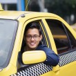 Portrait taxi driver smile car driving happy — Stock Photo #53246545