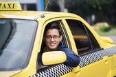 Portrait taxi driver smile car driving happy — Stok fotoğraf