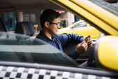 Taxi driver driving car happy counting money — Stock Photo