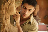 Sculptor young artist artisan working sculpting sculpture — Stock Photo