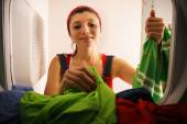 Woman Doing Housekeeping Taking Dry Clothes From Dryer At Home — Stock Photo
