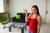 Portrait female home owner smiling holding keys new house  — Stok fotoğraf