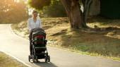 Woman Mother Mom With Toddler in Pushchair Walking In Park — Stock Photo