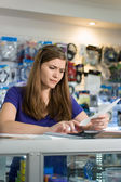 Worried Woman Checking Bills And Invoices With Calculator — Stock Photo