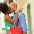 African American Couple Shopping With Credit Card Kissing — Stock Photo #73155393