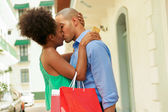 African American Couple Shopping With Credit Card Kissing — Stock Photo