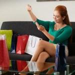 Latina Girl After Shopping Looks Fashion Necklace On Sofa — Stock Photo #73599703