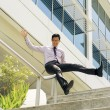 Happy Chinese Businessman Going Downstairs Sliding On Rail — Stock Photo #75578805